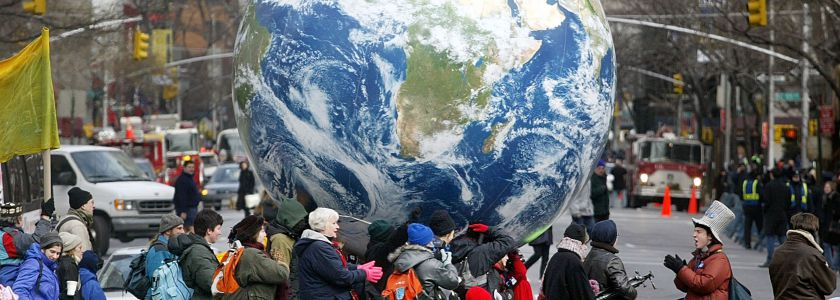 NEW YORK - FEBRUARY 15:  Protesters carry an inflatable globe during an anti-war demonstration February 15, 2003 in New York City. Tens of thousands attended the rally which coincided with peace demonstrations around the world.  (Photo by Mario Tama/Getty Images)