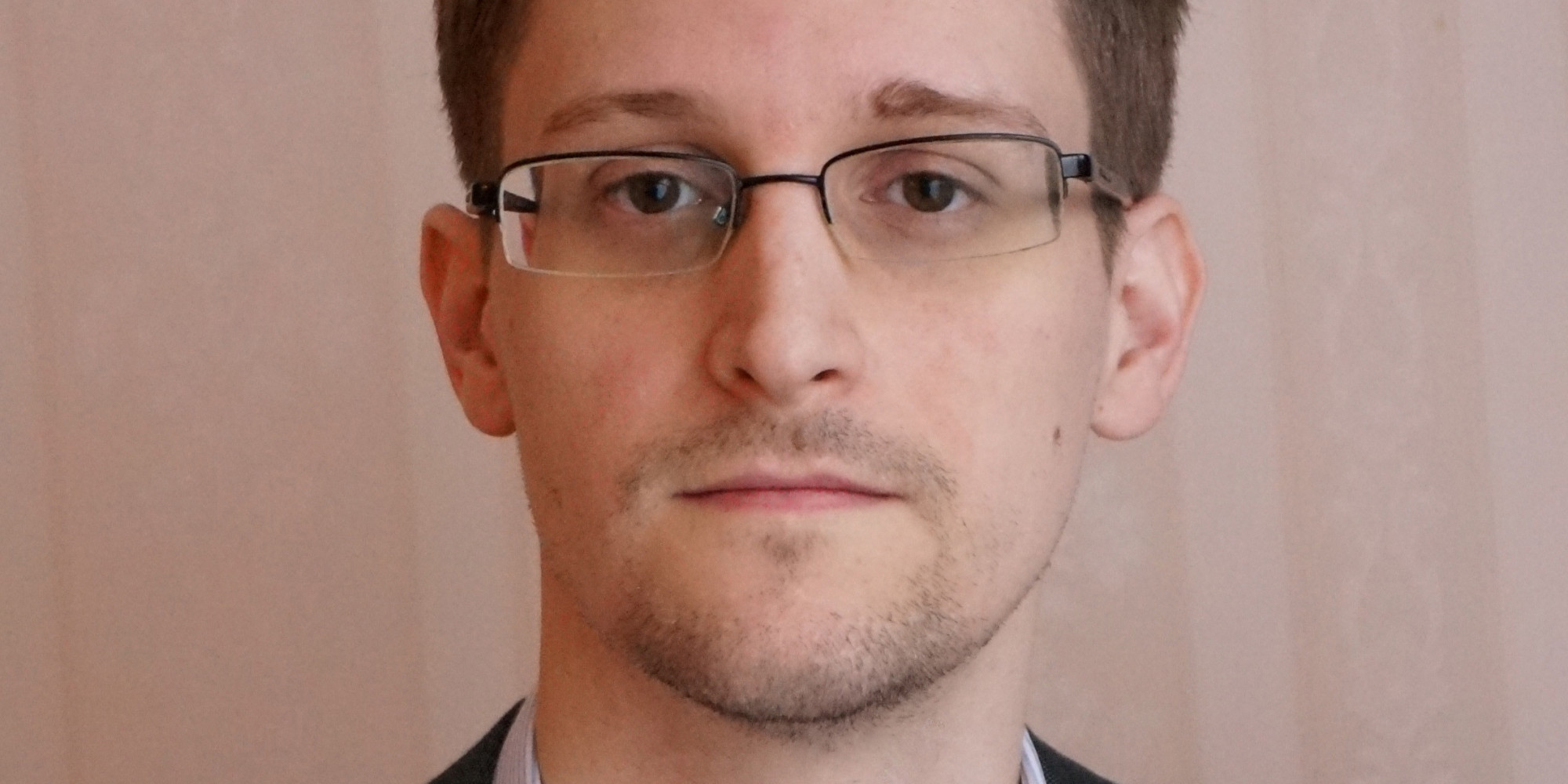 Former intelligence contractor Edward Snowden poses for a photo during an interview in an undisclosed location in December 2013 in Moscow, Russia